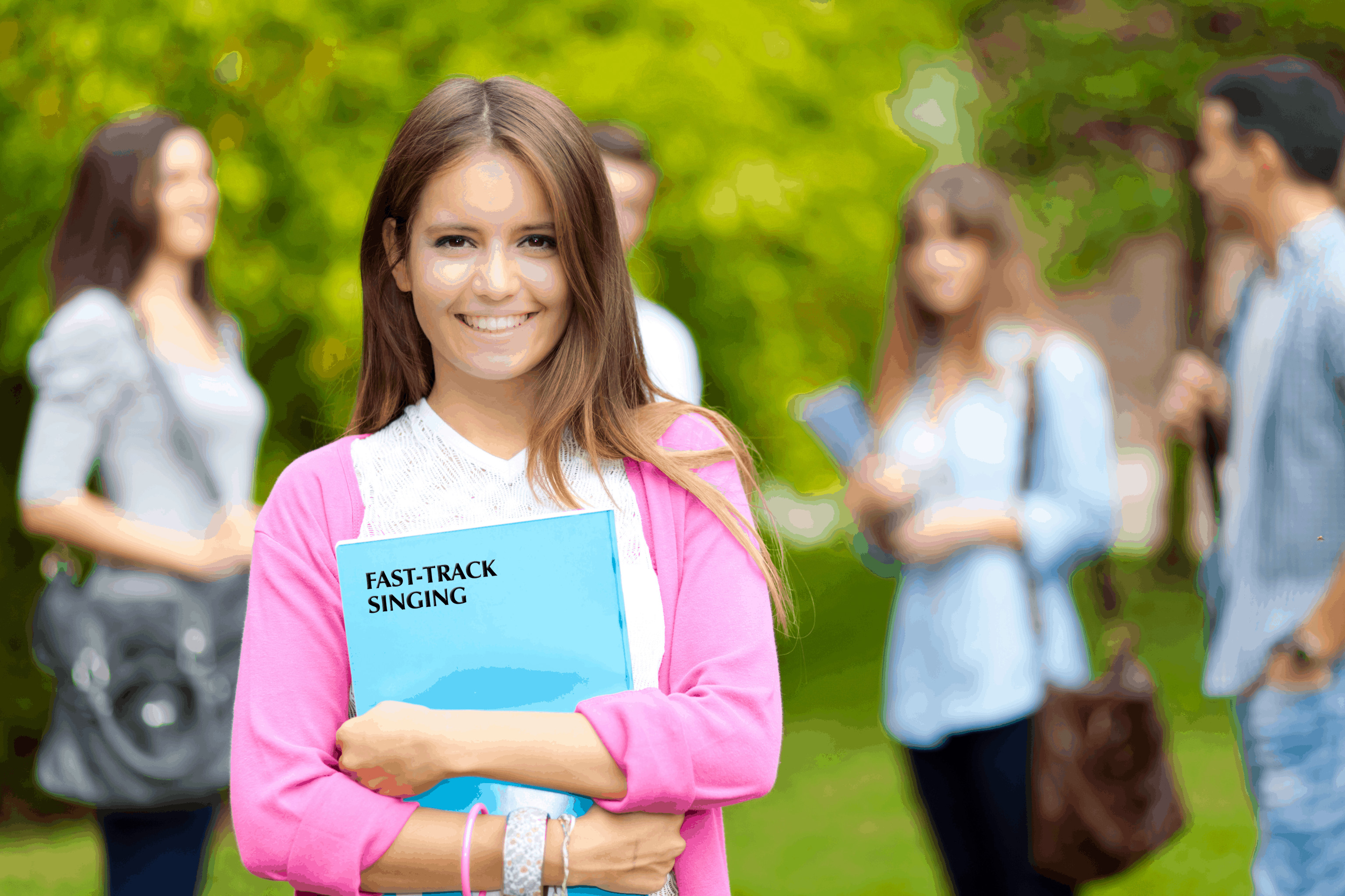 student smiling with book