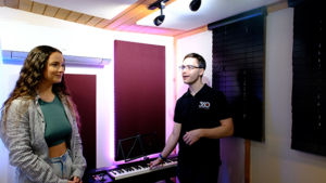 Girl having singing lessons with vocal coach